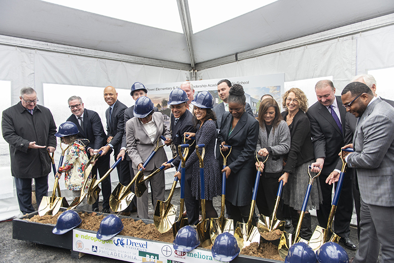 Members and partners in the SLAMS/Powel facility initiative break ground